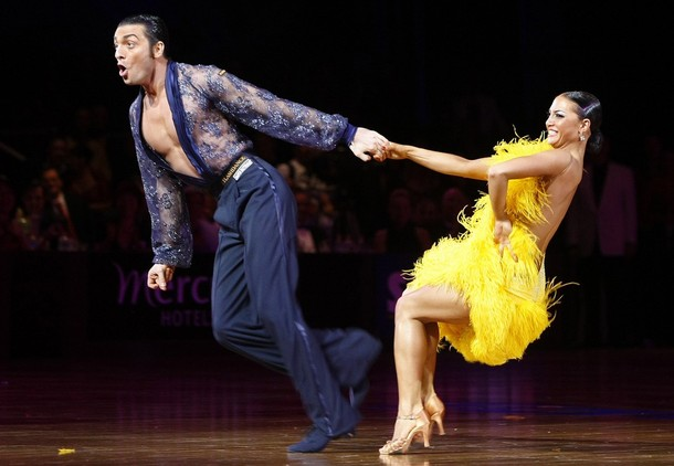 Italy's Stefano Di Filippo (L) and Anna Melnikova perform the honour dance after winning the World Latin Championship in Melbourne December 14, 2008. The International Dance Sport Federation (IDSF) World Latin Championship is a prestigious dance competition with an estimated 220 dancers from more than 60 countries competing. REUTERS/Mick Tsikas     (AUSTRALIA)